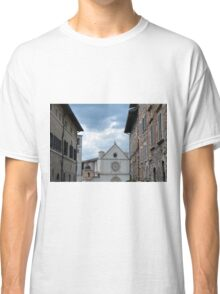 Buildings from Assisi leading to a white church. Classic T-Shirt