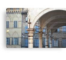 Arches and columns creating a portico in Siena. Metal Print
