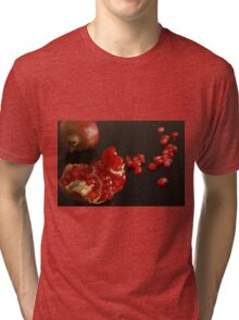 Pomegranate fruit and seeds on black background  Tri-blend T-Shirt