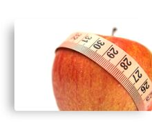 tape measure wrapped around an apple  Canvas Print