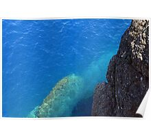The blue sea and rocky land. Poster