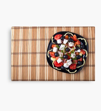 Top view of fresh vegetarian salad on a black square plate Canvas Print