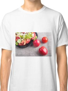 Close-Up top view on fresh tomatoes and a bowl of vegetarian salad Classic T-Shirt