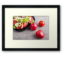 Close-Up top view on fresh tomatoes and a bowl of vegetarian salad Framed Print