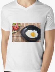 Close-up top view on a black plate with a fried egg Mens V-Neck T-Shirt