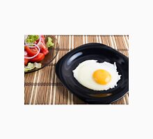 Close-up top view on a black plate with a fried egg Unisex T-Shirt