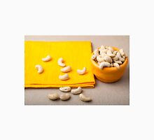 Selective focus on the tablecloth and raw cashew nuts closeup Unisex T-Shirt