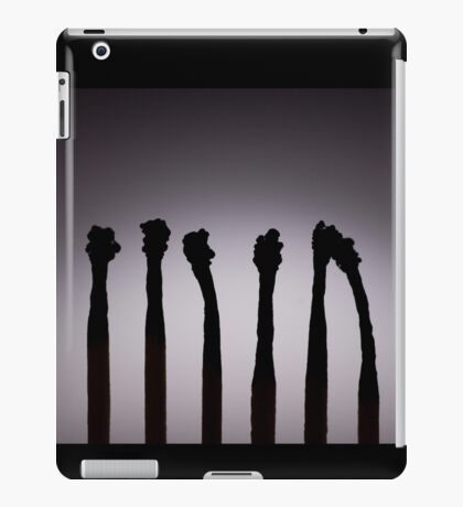 Silhouettes of burnt matches on vignetting background iPad Case/Skin