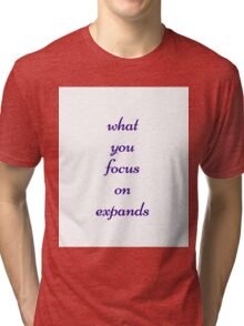 What you focus on expands Tri-blend T-Shirt