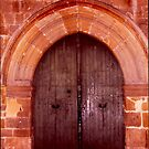 "door in an ""old city area"" by Yannis-Tsif"