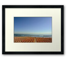 Long chairs on the beach in Rimini. Framed Print