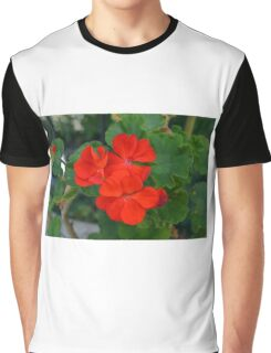 Red powerful color flower and green leaves background. Graphic T-Shirt
