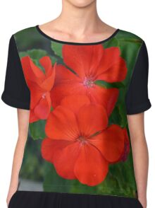Red powerful color flower and green leaves background. Chiffon Top