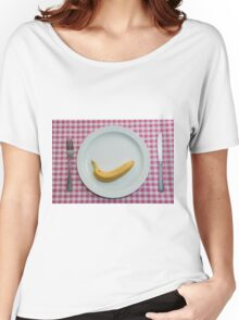 Knife, fork and plate with a banana on it on a red gingham table cloth. Women's Relaxed Fit T-Shirt