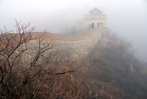 China - The Great Wall in the mist. by Jean-Luc Rollier