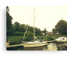 A boat on the Caledonian Canal Canvas Print