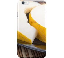 Juicy yellow melon on wooden background iPhone Case/Skin