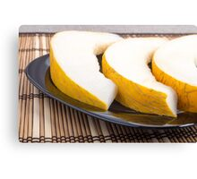 Juicy yellow melon on wooden background Canvas Print