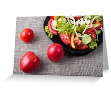 Close-Up top view fresh tomatoes and a part of a plate with vegetarian salad Greeting Card