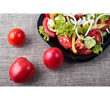 Close-Up top view fresh tomatoes and a part of a plate with vegetarian salad Photographic Print