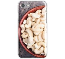Raw cashew nuts in a brown bowl on fabric background iPhone Case/Skin