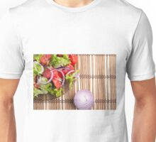 Close-up top view on a fragment of a translucent plate with a fresh salad Unisex T-Shirt