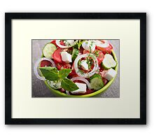 View close-up on a green bowl with a salad Framed Print