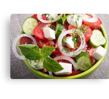 View close-up on a green bowl with a salad Canvas Print
