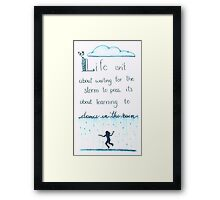 Learn to dance in the rain Framed Print