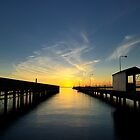 Sunset between the piers by collpics