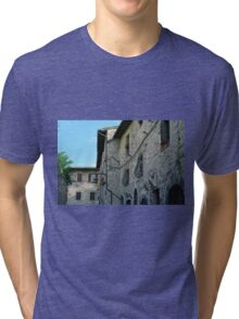 Stone facade buildings on the street in Assisi Tri-blend T-Shirt