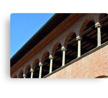 Simple brick facade from Siena with columns and arches. Canvas Print