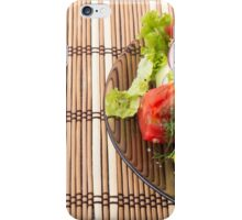 Vegetarian salad from fresh vegetables on a bamboo mat iPhone Case/Skin