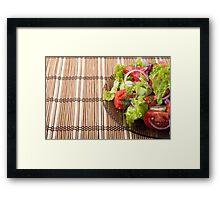 Vegetarian salad from fresh vegetables on a bamboo mat Framed Print