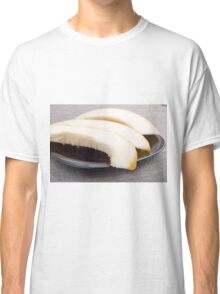 Natural pieces of yellow melon on a black plate Classic T-Shirt