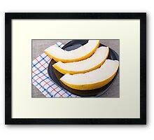 Dessert of sweet yellow melon slices Framed Print