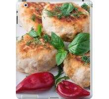 Rissole of minced chicken on a white plate with red pepper iPad Case/Skin