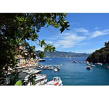 6 August 2016. Photography of the beautiful Portofino fishing village in Italy. View on small bay and colorful houses at town of Portofino in Liguria, Italy. Photographic Print
