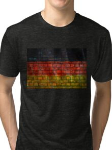 German flag painted on old brick wall Tri-blend T-Shirt