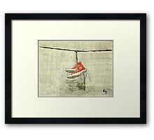 Wire and sneakers.  Framed Print