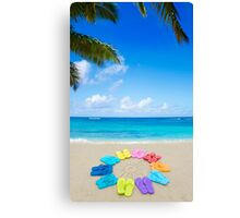 Color flip flops and drawing sun on sandy beach Canvas Print