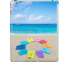 Color flip flops and drawing sun on sandy beach iPad Case/Skin