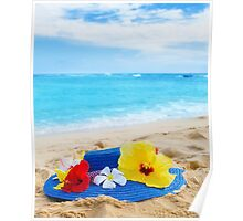 Woman's hat with tropical flowers on sandy beach Poster