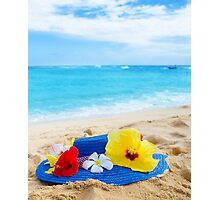 Woman's hat with tropical flowers on sandy beach Photographic Print