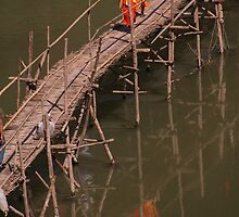 Reflective Buddhism - crossing the Kahn River Laos by indiafrank