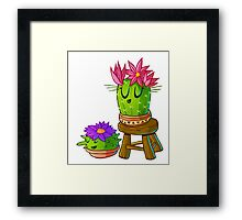 Cute cactus on stool Framed Print