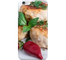 Close Up view on rissole of minced chicken on a white plate iPhone Case/Skin