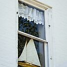 Look At What's In The Lighthouse Window by Robert Kelch, M.D.