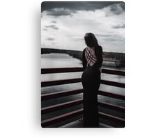 model in black dress looking in to river  Canvas Print