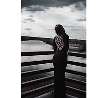 model in black dress looking in to river  Photographic Print